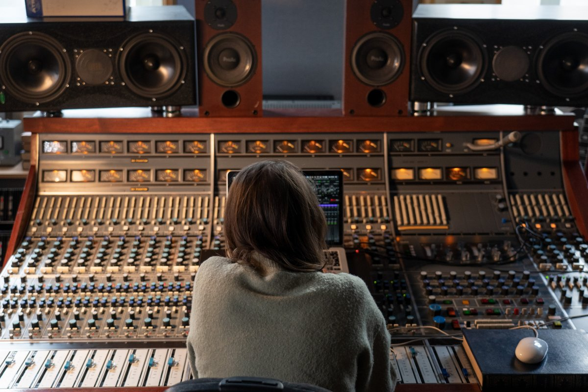 Audio engineer Dani Bennett Spragg sitting in from of a mixing console