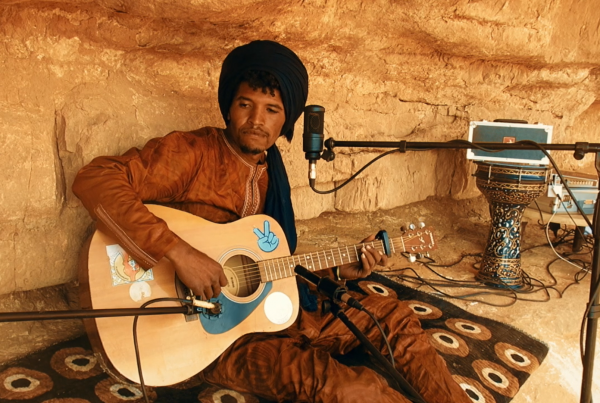 Abdelkrim recording in a desert environment